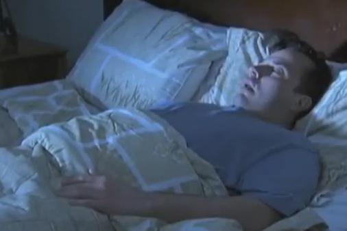 What is Sleep Apnea - Man sleeping restlessly in bed